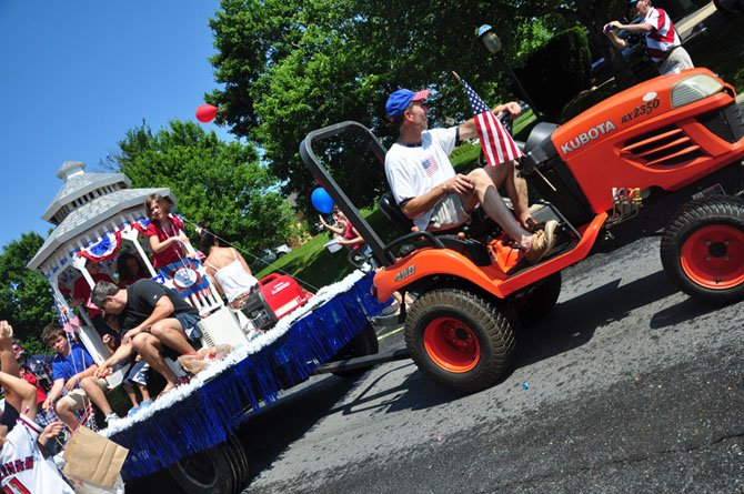 Mike Kearney, owner of the Old Brogue, drives the Celebrate Great Falls float during the annual Fourth of July parade.