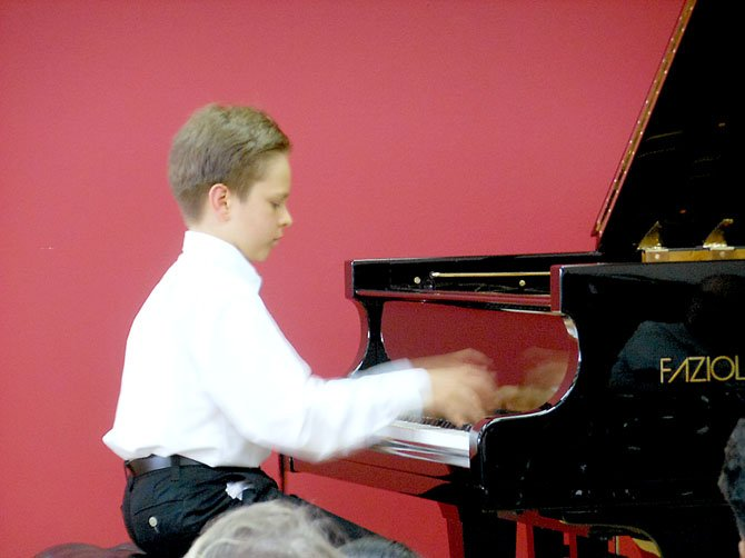 Ten-year-old Anton Nelsons hands are a blur as he performs at a solo recital Friday, July 6 at The Piano Company in Leesburg.