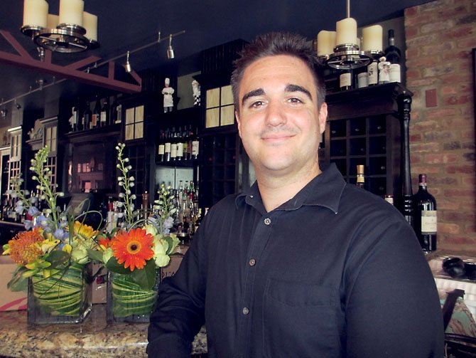 "Michael Manetti, a longtime waiter at Bazin's on Church, was tipped $1,000 for his service on July 6. ""I was in shock,"" Manetti said."