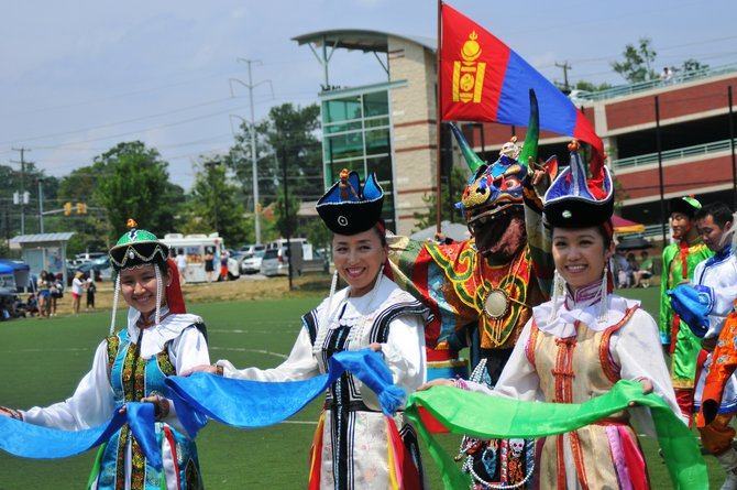 Tsolmon Uramchimeg leads her traditional dancers around the field in parade.