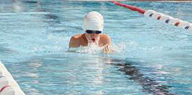 Chinquapin swimmer Ronan Lauinger broke the Colonial Swim League's 34-year-old record in the boys' 8U 25-yard breaststroke on July 7.
