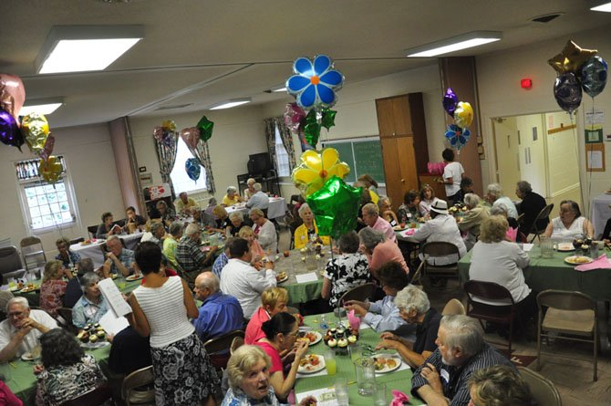Guests at the first Great Falls Senior Center Activity enjoy lunch Tuesday, July 10 at the Great Falls United Methodist Church.