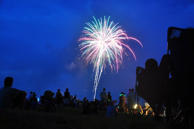 Guests watch fireworks on the lawn at Turner Farm Saturday, July 14.
