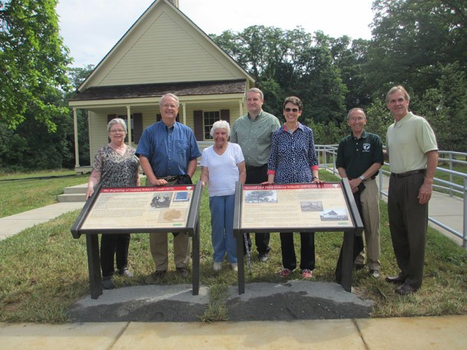 County Park Authority preservation specialist Karen Lindquist, HMDL historian Charles Balch, great-granddaughter of first schoolhouse teacher Pat Price, HMDL historian Steve Hull, Providence District Supervisor Linda Q. Smyth, County Park Authority Board Providence District Representative Ken Quincy, and County Park Authority Director John Dargle, Jr. unveil interpretive panel markers at the Oakton Schoolhouse.