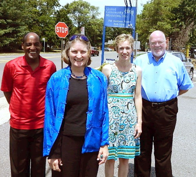 Shirley Marshall is flanked by some of her staff: Terry Bibbs (left), director of human resources, Niki Wanner, director of development and communications, and Herb Lea, director of community programs.