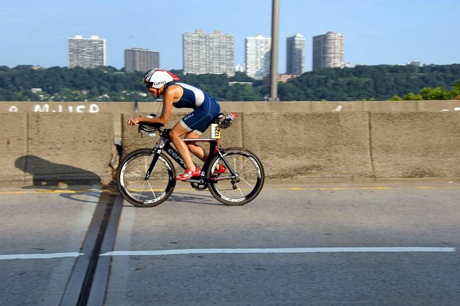 Bethesda resident and Potomac Pedalers member Nancy Avitabile, 64, competes in the New York City Triathlon on July 8. Avitabile finished first in her age group.