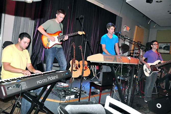 From left, Xander Green, Matt Brown, A.J. Smith and Lloyd Kikoler perform at  Cafe Montmartre in Reston Friday, July 13. Smith, a Herndon native, was recently awarded a scholarship at NYU, where he is a junior, for his songwriting.