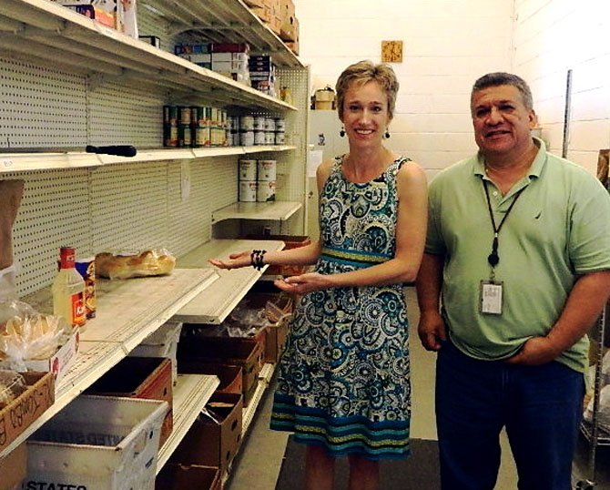 Niki Wanner shows off UCM's empty shelves. With her is food pantry manager Jose Fratti.