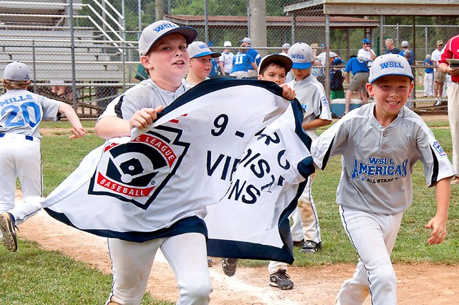 Alec Reilly and teammates take the winner's banner on a victory lap. West Springfield Little League 9-10 American All-Stars head to states.