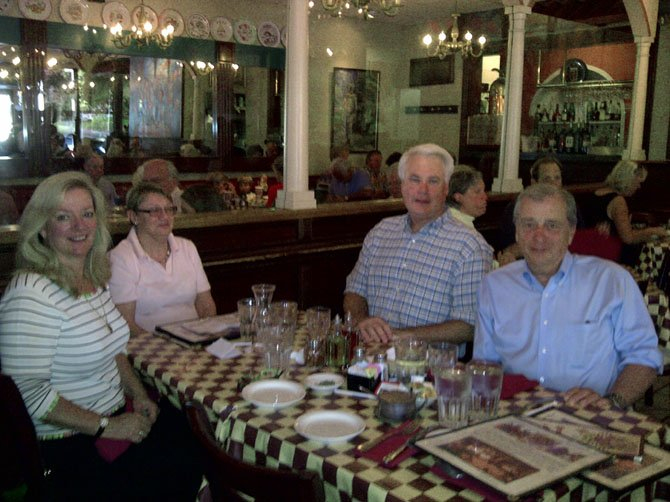 Enjoying dinner at Pulcinella Italian Host while raising money for McLean Project for the Arts, from left: Robin Walker, Sandy Treanor, Bill DuBose and Tom Campbell.