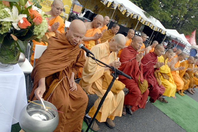The 9th Annual Asian Festival held on the campus of George Mason University opened this year with a Buddhist Alms ceremony, with area Buddhists giving alms to monks from around the region.