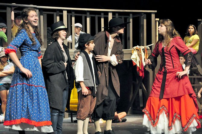 "From left, Sarah Overton, Alycia Adams, Ethan Van Slyke, Chris Hrozencik and Megan Overton in a summer performance of ""Oliver!"" at Herndon High School."