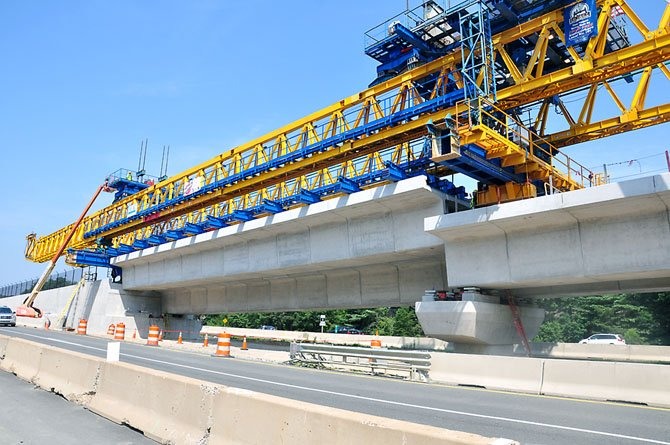 The final aerial span for the Tysons Corner Metrorail guideways is ready to be lowered into place Tuesday, July 17.