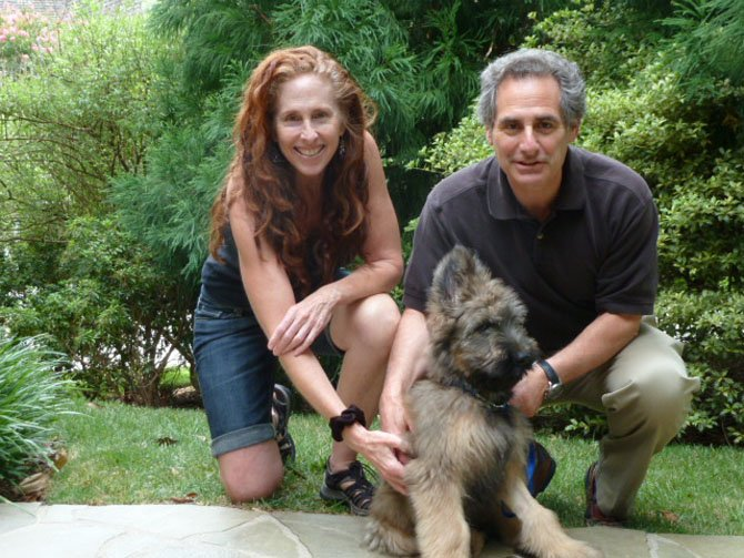 The Rosenbergs and their puppy Chance.