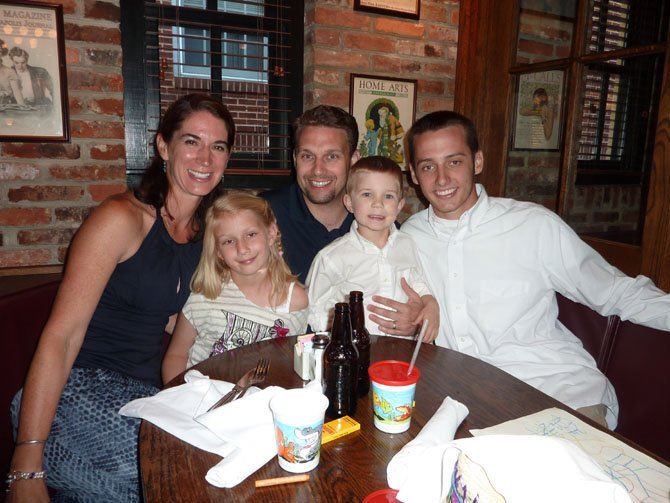 Alexandria Aces pitcher Steven Schulter, right, enjoys the Meet the Aces dinner with his host family, Jonelle and Henry Wallmeyer and Mary Francis, 6, and Nicklaus, 4.
