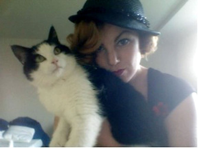 Esme Bass of Springfield poses with her cat, Jack.
