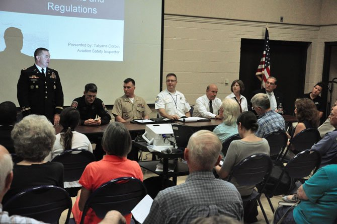 Local aviation officials discuss helicopter noise with McLean residents at the McLean Community Center Thursday, July 26.