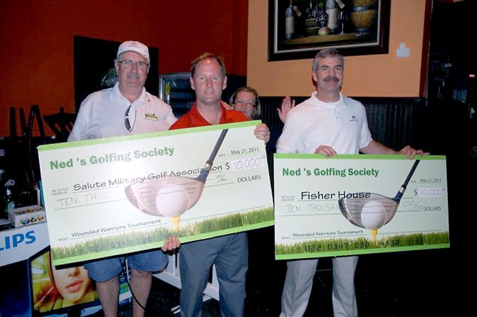From left, Dave Lewis of Ned Devine's Golfing Society, Jim Estes of the Salute Military Golf Association and Brian Gawne of Fisher House, with funds raised by last year's golf tournament to benefit wounded warriors. This year's tournament will take place Sept. 22 at Herndon Centennial Golf Course.