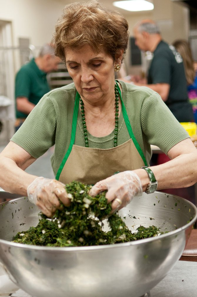 Madelyn Nader, Food Chair for the September bazaar, prepares the spinach mixture for the pies.