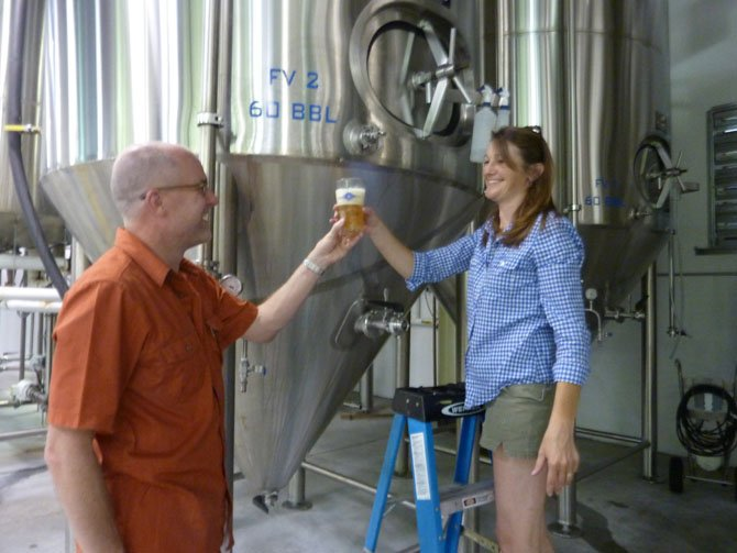 Alexandria's John Bordner, left, gets a sneak preview of Port City Brewing's new Derecho Common beer from tasting room manager Jennifer Chace. The limited edition beer will be officially tapped Aug. 3 at 3 p.m.