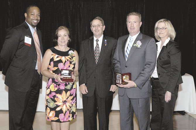 From left are Loren Rufino, Jennifer Campbell, Michael Frey, John Cleveland and Lynne Strobel. Rufino and Strobel are members of the Celebrate Fairfax Board of Directors.
