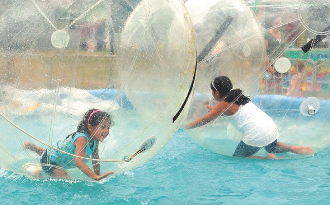 The Moyano sisters enjoyed an escape at the 2011 fair in the air bubbles above the water pond.
