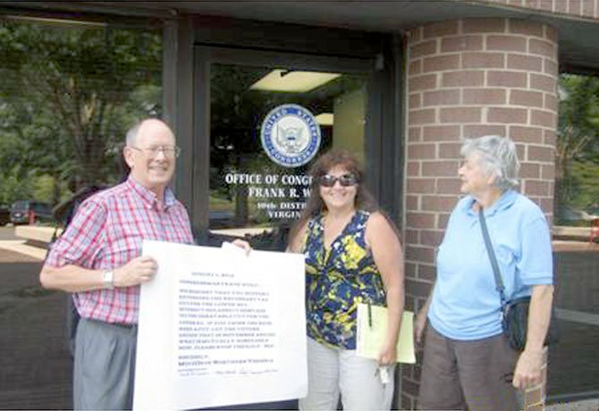 Pictured outside the Herndon office of Rep. Frank Wolf (R-10) are David McCracken, Margo French and Linda Chernisky. McCracken and French are co-coordinators of the council, which represents over 17,000 MoveOn members in the 10th District.