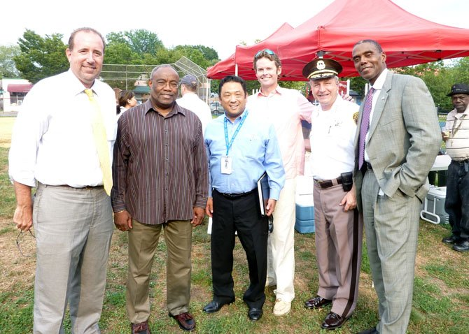 City Councilman Frank Fannon, Mayor Bill Euille, Daniel Mineta, Brian Porter, Sheriff Dana  Lawhorne and City Attorney James Banks gather at the Mount Vernon Recreation Center field Aug. 7 to kick off National Night Out festivities.