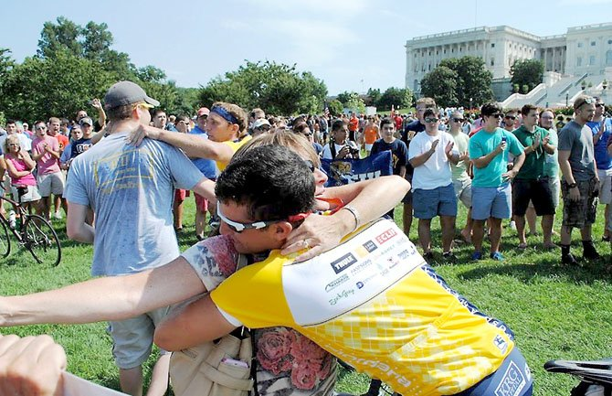 Mom Anne Marie Rieck waited several hours with family and friends in the blistering heat on Sunday, Aug. 5, to give son Dan Rieck a homecoming hug during a celebration and parade held on the west lawn of the U.S. Capitol.