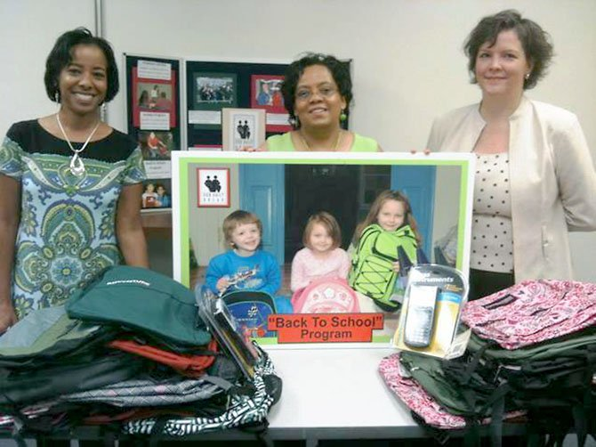 From left, Wren Kelly-King and Lauren Fallen of the Divine Dining Divas present $700, 52 backpacks and four scientific calculators to Our Daily Bread Development Manager Jennifer Rose to support ODB's 2011 Back to School Program. The donations were made by their fellow group members and their colleagues at the Fairfax County Department of Safety Communications.