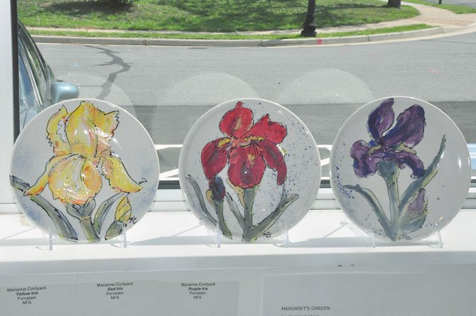 A selection of plates created by artist Marianne Cordyack to pay tribute to the irises at the garden of Margaret Thomas.