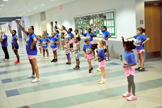 Members of Reston Youth Cheer practice at South Lakes High School. The group is open to girls from kindergarten to 12th grade.