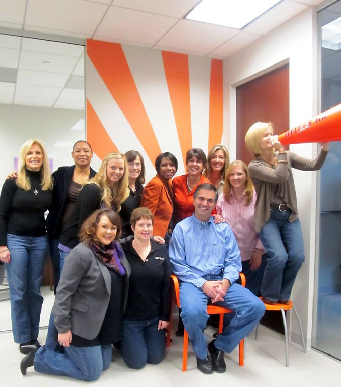 The staff of Helios HR in Herndon, one of Fairfax County's thriving women-owned businesses: (Back row, from left) Stephanie Eberhart, Andrea Parker, Sarah Smith, Ellyn Krause, Judy-Ann McKenzie, Kathy Albarado, Stephanie Kotch, Stacey Holst (Front Row, from left) Natalie Oddenino, Michele Wooding, Dean Klein, Amy Levin-Murchie.