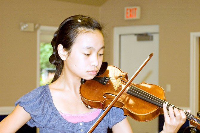 Violinist and Thoreau Middle School student Elizabeth Wu, 11, prepares her violin piece for the Summer Strings Camp final concert, held on Aug. 7.