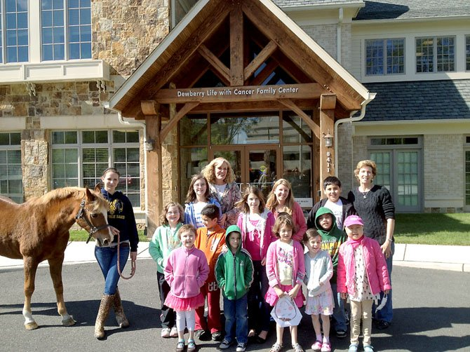A horse and member of the Northern Virginia Therapeutic Riding Program visit children at Life with Cancer. The children pictured are a mixture of those currently battling cancer, survivors and family members.
