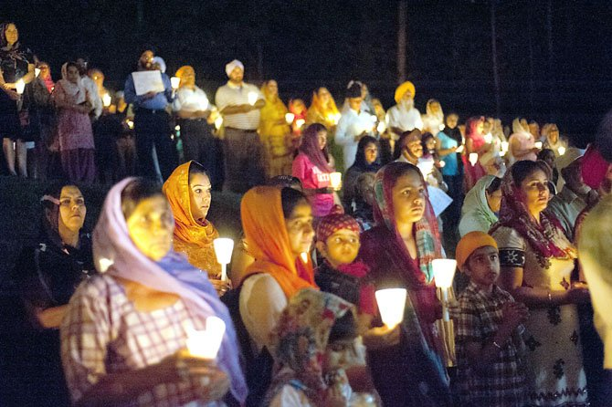 More than 300 people of all faiths gathered for a candlelight vigil at the Sikh temple in Fairfax Station on Thursday, Aug. 9, less than a week after a gunman opened fire at a Sikh temple in Wis., killing six and injuring three.