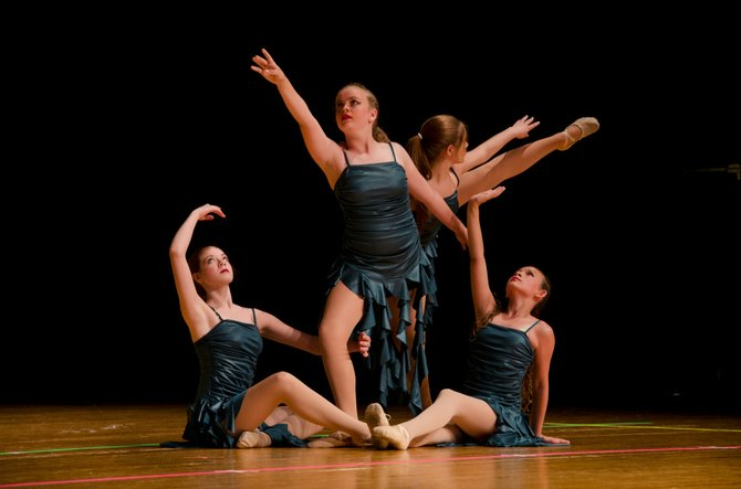 Recital performance of 'Rapunzel' at W. T. Woodson High School. The girls dance a contemporary piece titled 'Chariots.'