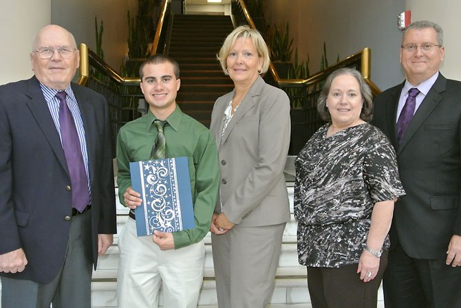 Adam Miner, a winner of the 2012 Ben DeFelice Scholarship, is with Northwest Federal Credit Union Foundation board members Juri Valdov, Mary DeFelice, Gerrianne Burks and William Cook.