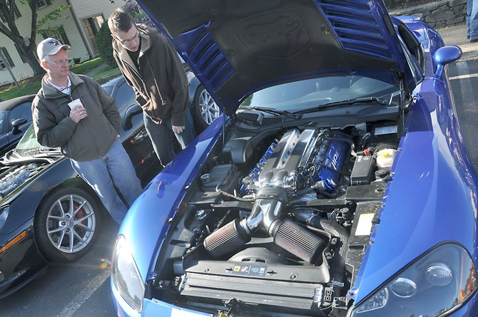 From left, Greg and Ken Fulmer examine a viper on display at Cars and Coffee.