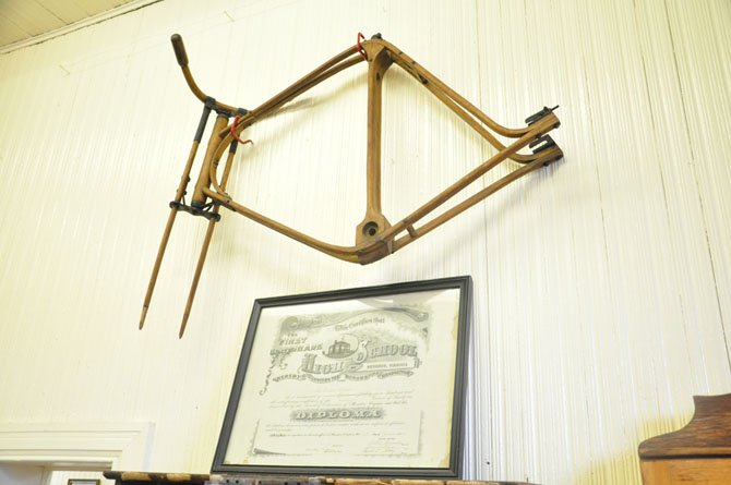 A Herndon High School diploma from 1949 and bicycle frame made out of wood by Herndon resident William Kephart built around 1900, on display at the Herndon Depot museum.