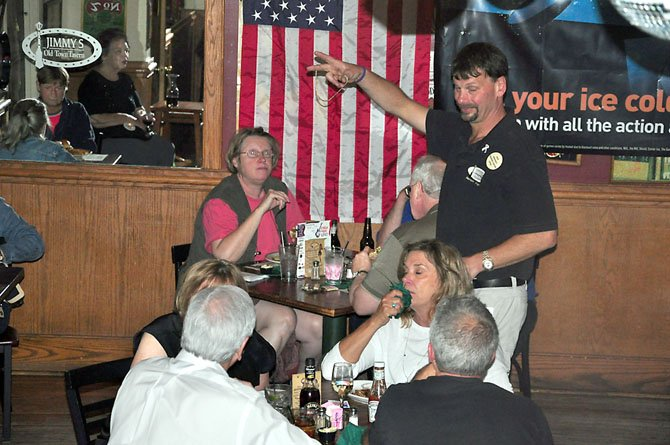 Jimmy Cirrito, owner of Jimmy's Old Town Tavern, greets customers during a recent fundraiser at the tavern.