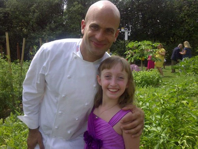 Madeleine Steppel, 9, meets White House Assistant Chef Sam Kass Monday, Aug. 20, after winning an online competition.