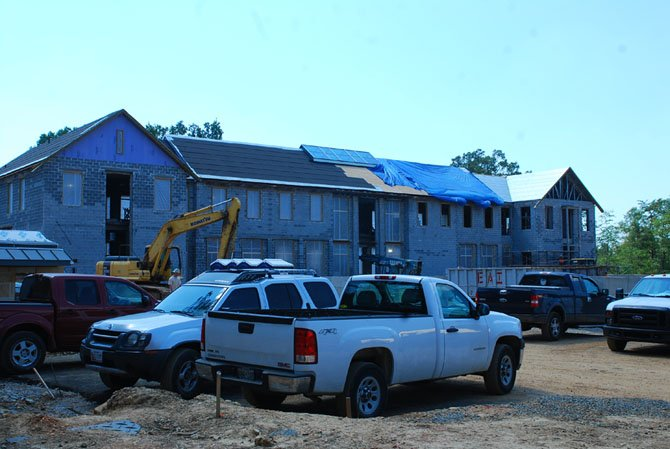 Construction workers are busy Aug. 15 as the new George Washington library takes shape at the Mount Vernon Estate.