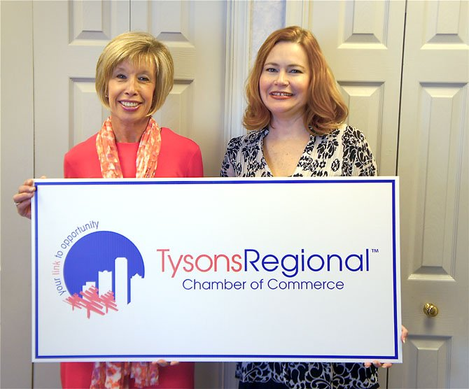 From left—Office Administrator/Events Planner Sharon Brown and Tysons Regional Chamber of Commerce President Lisa Huffman display the chamber's new name and logo.