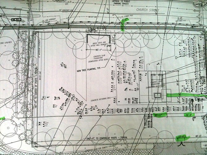 Detailed construction plans of Contrabands and Freedmen's Cemetery: Ovoid shapes with Rectangle inlays indicate known grave sites and place markers in position. Larger rectangle shapes in photo represent remnants of office building and gas station.