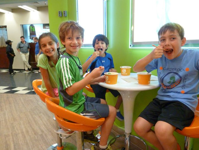 From left: Jacob Fienberg, Lindsay Fienberg, Jack Feldman and Max Miller enjoy Orange Leaf Frozen Yogurt.