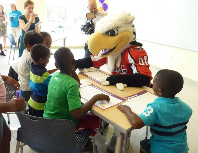 Washington Capitals mascot Slapshot joins in the fun during Design Day at the Charles Houston Recreation Center.