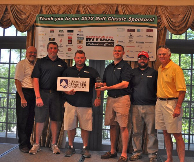 Alexandria Chamber of Commerce president John Long, left, is joined by Wiygul Automotive's winning team of George Ball , W.D. Wiygul, Zack Wiygul and Dave Krukowski following the annual golf tournament at Belle Haven Country Club Aug. 27. At right is tournament committee chairman Roger Parks.