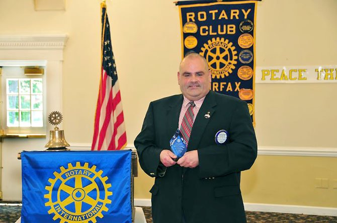 Rick Schroeder, member of The Rotary Club of Fairfax, receiving the Service Above Self award. Photo courtesy of Irby Hollans.