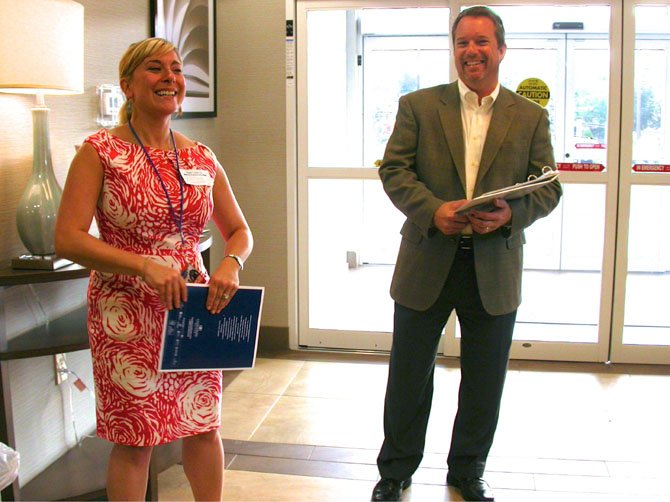 Chamber Chairman Michael Gailliot and June Campola of Candlewood Suites welcome guests.